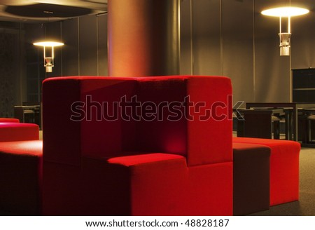 interior of modern living room with red sofas