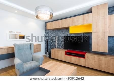 interior of modern living room with TV set