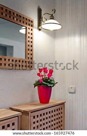 interior of modern lobby with mirror and desk - stock photo