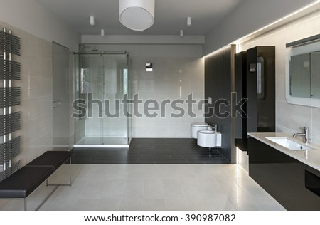 Interior of modern luxury bathroom in minimalistic style - stock photo