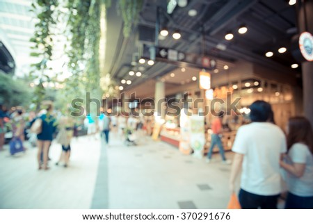 Interior of modern mall with some people in it - stock photo