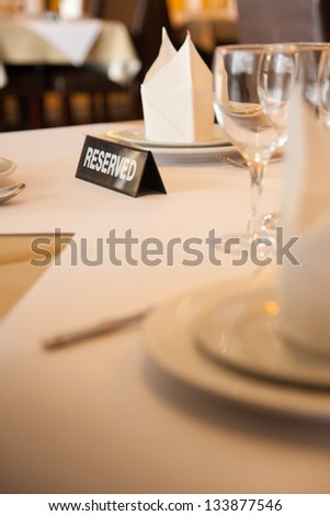 interior of modern restaurant , empty glass on table. - stock photo
