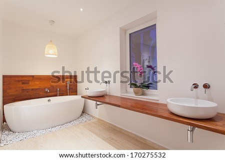 Interior of modern spacious bathroom with window - stock photo