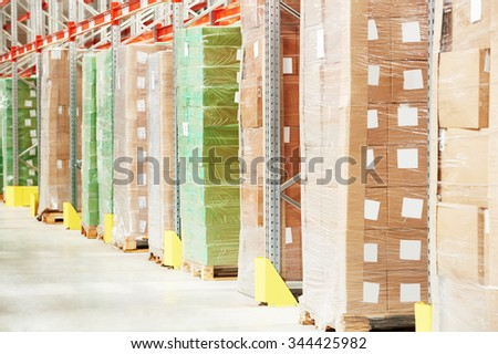 Interior of modern warehouse. Rows of shelves with boxes - stock photo