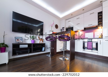 Interior of modern white living room with kitchen