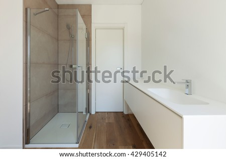 Interior of new apartment, bathroom with shower and sink