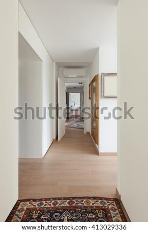 Interior of new apartment, corridor with parquet floor and carpet - stock photo