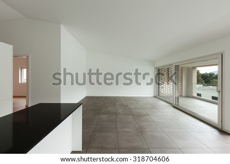 interior of new apartment, empty room with domestic kitchen - stock photo