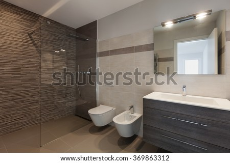 interior of new apartment, modern bathroom with shower - stock photo