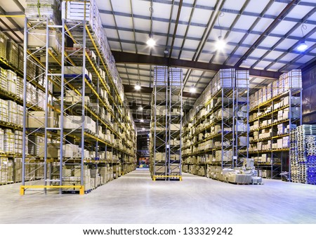 Interior of new large and modern warehouse space - stock photo