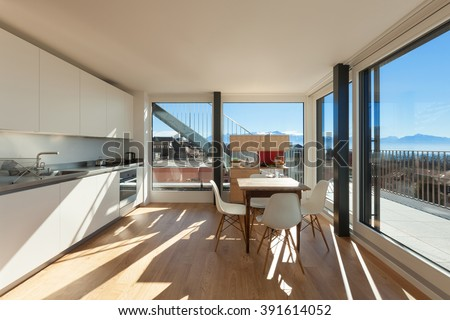 Interior of nice apartment, domestic kitchen with breakfast table - stock photo