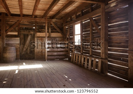 Interior of old barn - stock photo