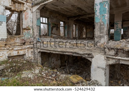 Interior of old factory buildings destroyed. Ruins of industrial enterprise, dark debris destroyed factory premises in factory as result of economic crisis and earthquake. Catacombs, basement, tunnel