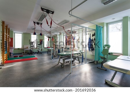 Interior of physiotherapy clinic with equipment for rehabilitation