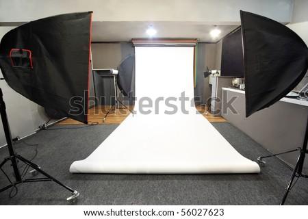 interior of professional photo studio with white background - stock photo