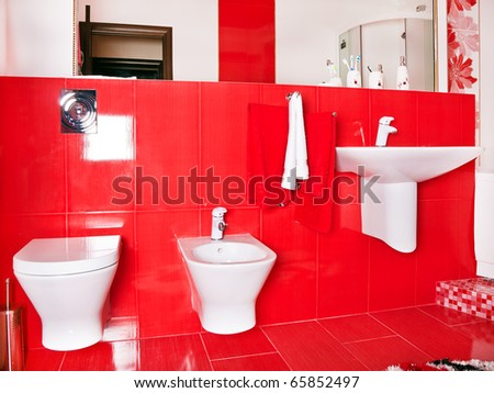 Interior of  red bathroom in modern house - stock photo