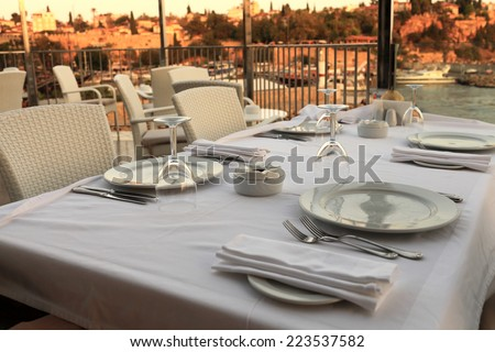 Interior of restaurant on a cliff at sunset - stock photo