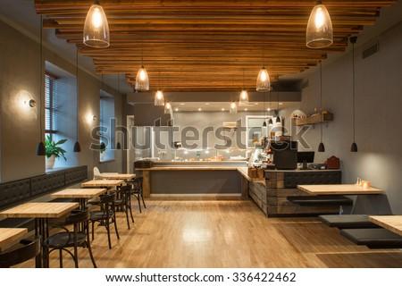 Interior of restaurant. Wooden design. - stock photo