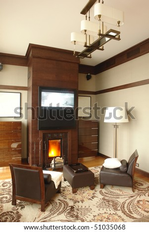 interior of room with fireplace and armchairs - stock photo