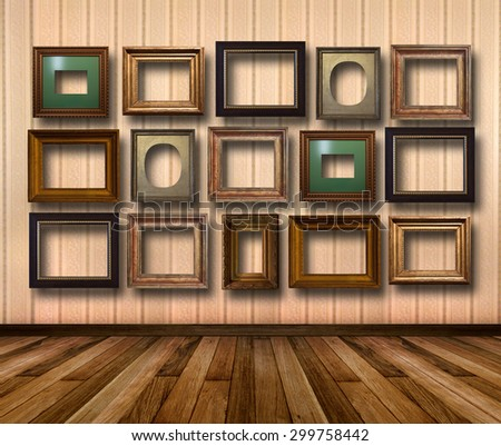 Interior of room with striped wallpaper and gold wooden frames for paintings - stock photo