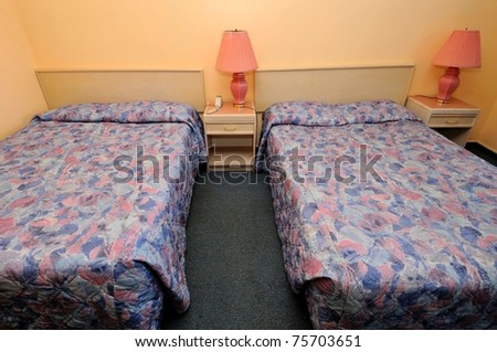 Interior of simple and comfortable room with twin beds. - stock photo