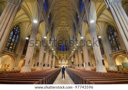Interior of St. Patrick's Cathedral, a famed neogothic Roman Catholic Cathedral in New York City. - stock photo