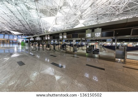 Interior of the airport with a view on exit - stock photo