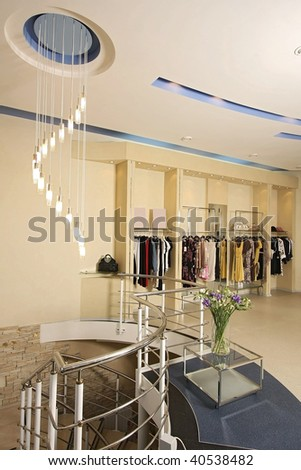 Interior of the big shop of fashionable clothes