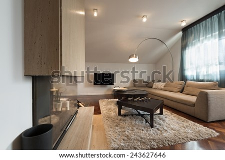 Interior of the loft apartment - living room with fireplace  - stock photo