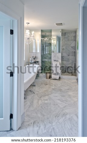 Interior of the luxury modern bathroom with marble floor. Vertical. - stock photo