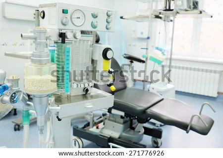interior of the operating room in dental clinic with the anesthesiology machine on the frontground - stock photo