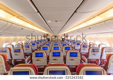 Interior of the passenger airplane, an empty passenger airliner - stock photo
