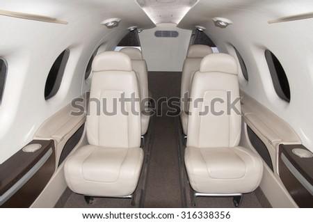 interior of the passenger small plane - stock photo