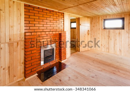 Interior Of The Sauna - Window, Fireplace. Stove in the bath - stock photo