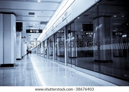 interior of the subway station in shanghai china. - stock photo