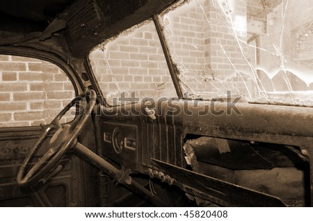 interior of the wreck of an old truck cab, circa 1930.  Finished in sepia-toned monochrome