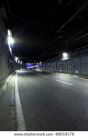 Interior of urban tunnel without traffic - stock photo