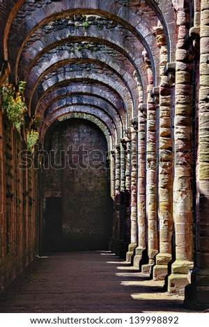 Interior of very old Gothic style monastery - stock photo