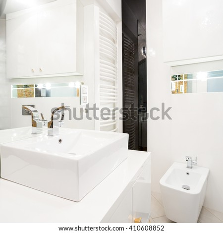 Interior of white bathroom with porcelain elements - stock photo