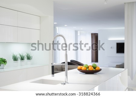 Interior of white kitchen with color details - stock photo