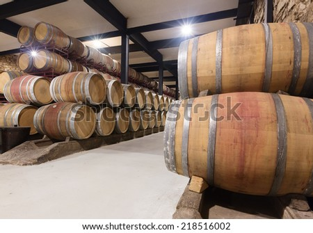 Interior of  winery with wooden barrels - stock photo