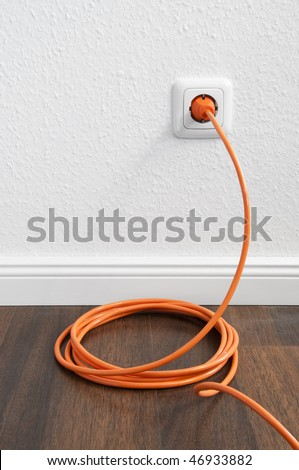 Interior outlet with cable plugged in - stock photo