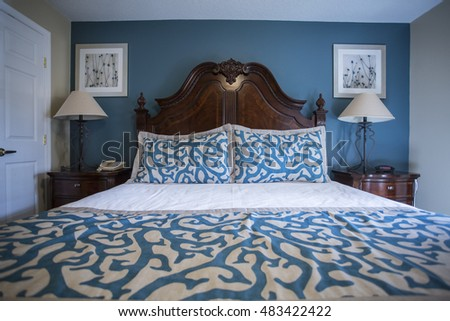 Interior photo of a Large wooden bed in an Attractive, elegant bedroom with modern decor