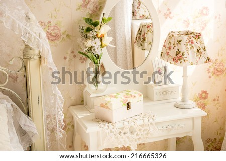 Interior photo of table with mirror and flowers in provence style - stock photo