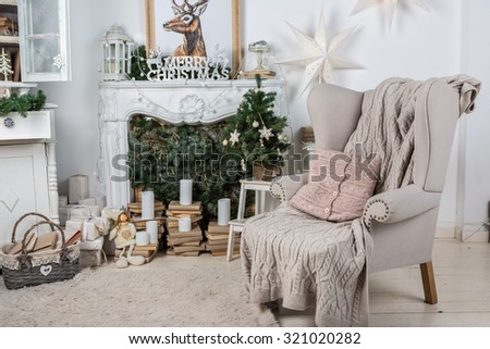 Interior room decorated in Christmas style. No people. An empty chair. Neutral colors. Home comfort of modern home. A series of photos