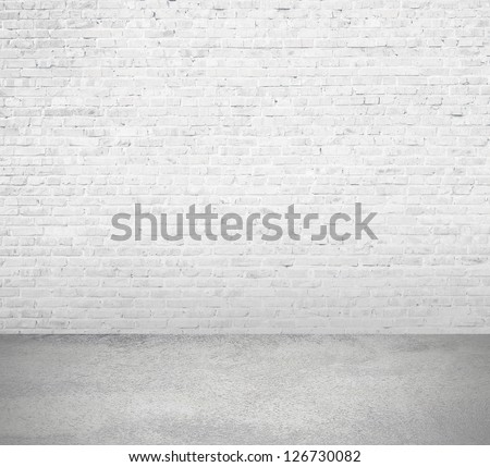 interior room with white brick wall and floor - stock photo
