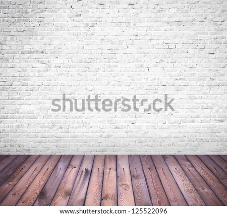 interior room with white brick wall and wooden floor - stock photo