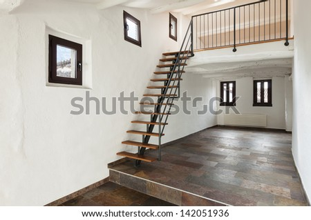 interior rustic house, large room with staircase