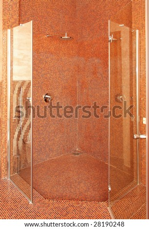 Interior shot of big shower with contemporary tiles