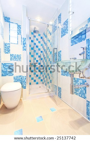 Interior shot of modern and new blue bathroom - stock photo